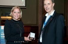 Rianne Letschert is awarded the YAE Medal 2018 by Marcel Swart, former YAE Chair