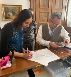 Mangala Srinivas signing on behalf of the YAE