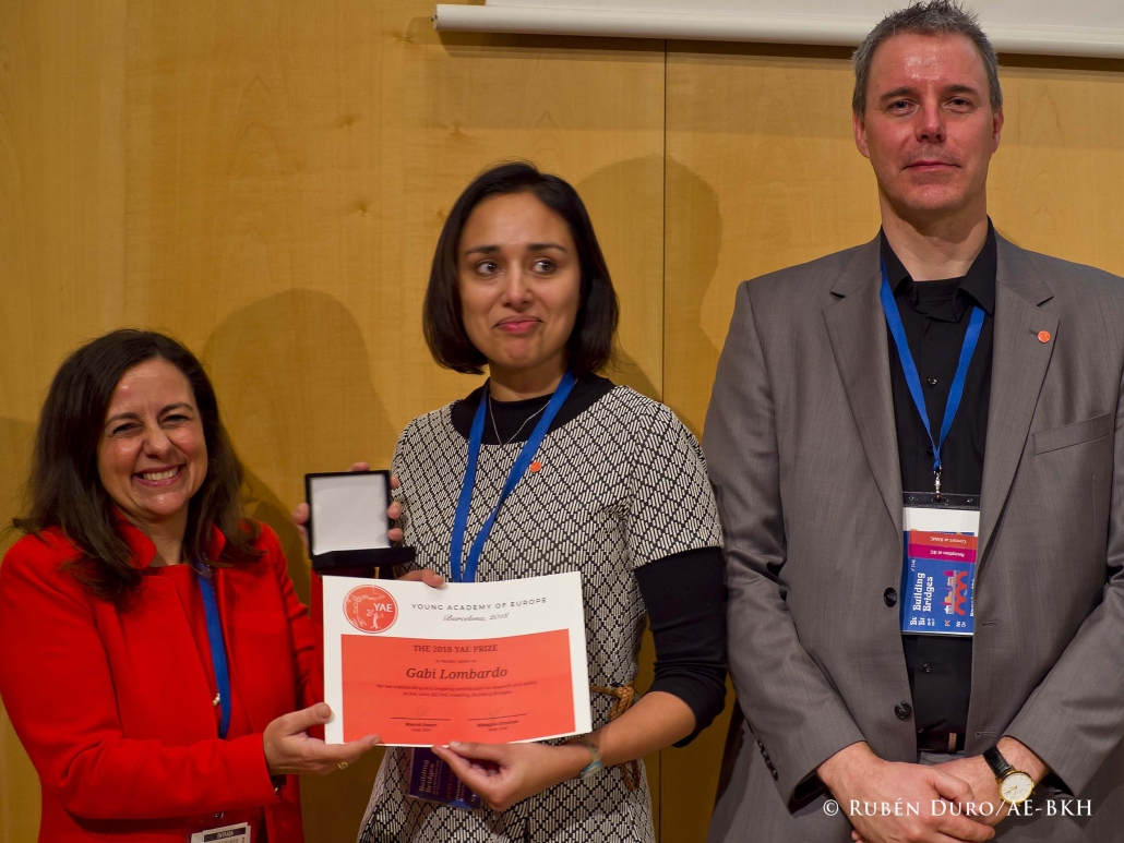 Dr Gabi Lombardo is awarded the YAE Medal 2018 by YAE Chair Dr Mangala Srivinas and former YAE Chair Marcel Swart